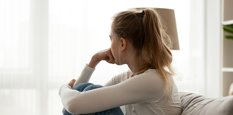 Stressed woman looking away