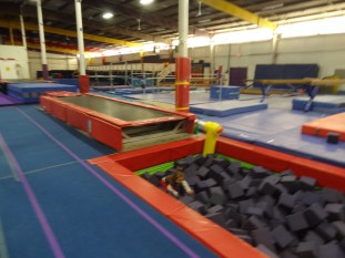 Trampoline track and foam pit