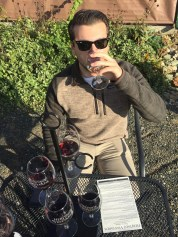 """Nick Morello, 21, an Advertising major at Rowan University, selected the Reserve Wine Flight at Heritage Vineyard in Mullica Hill, N.J., Wednesday October 26, 2016. Morelo selected this flight because he enjoys dry red wine. (Photo/Amanda Dean)""""2012 BDX was my favorite wine. This wine very earthy, it has a nice a light oak flavor to it,"""" said Morello."""