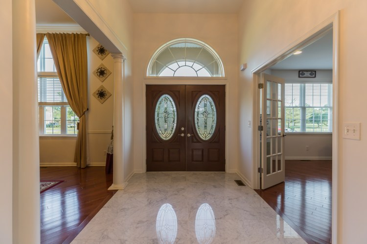 The foyer showing marble floors