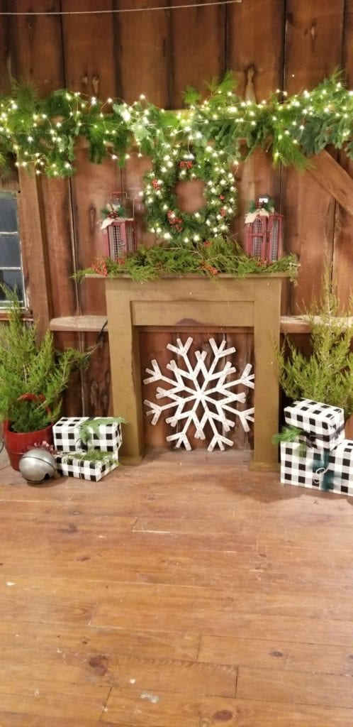 Red barn mantle dressed for the holiday