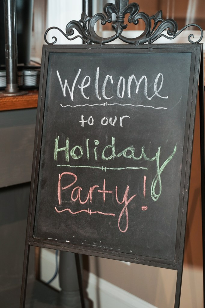 Chalkboard says Welcome to our Holiday Party
