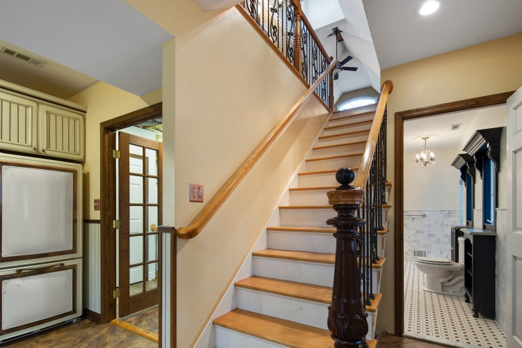 The wrought iron balusters add character to the stairs.