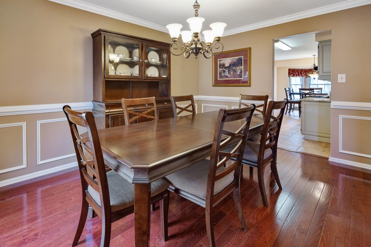 The formal dining room is dressed up with custom trim work