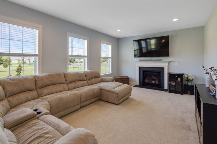 Family Room with fireplace and recessed lighting.
