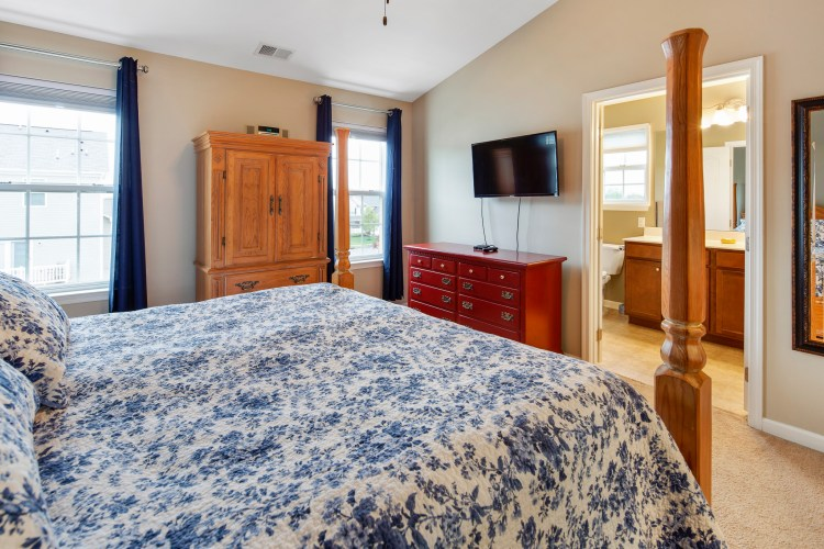 The Master Bedroom at 460 N Palace Drive offers vaulted ceiling and ceiling fan
