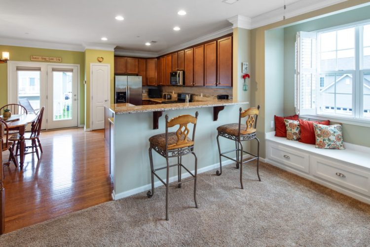 Photo shows breakfast bar and window seat