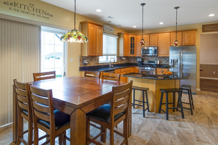 The wonderful eat-in kitchen has access to the patio.