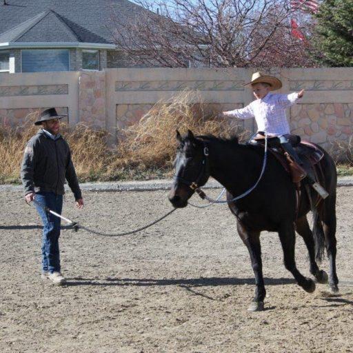 JR teaching his son to ride
