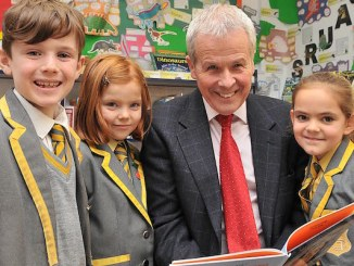 John Kennedy with Greenbank pupils Toby Dunn, Charlotte Holmes and Amelia Leach