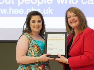 Olivia Lingard receiving her certificate from Sally Cheshire, Chair of Health Education England North West