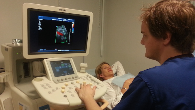 Patient Linda Clifton receives a pelvic ultrasound scan from a technician.