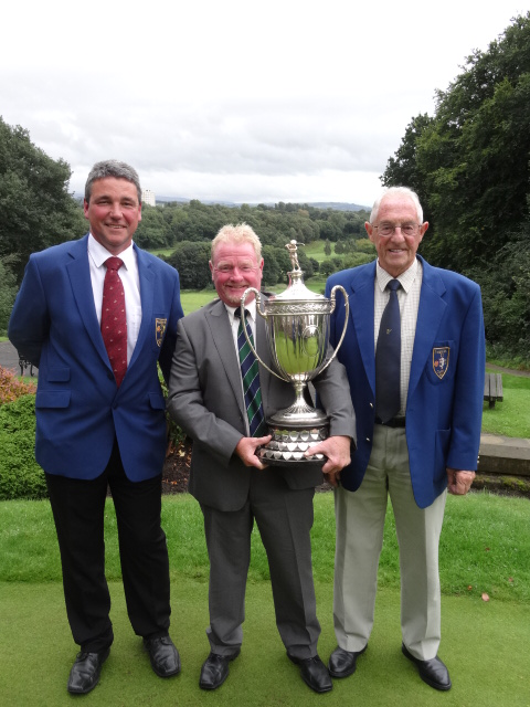 Andrew with Reddish Vale captain Tony Barnes and president Derek Wilson