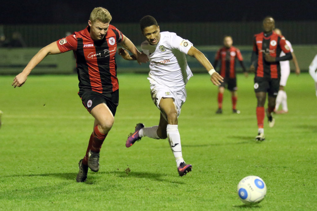 Kaine Felix (right) chases the ball down for Stockport, against Brackley Town