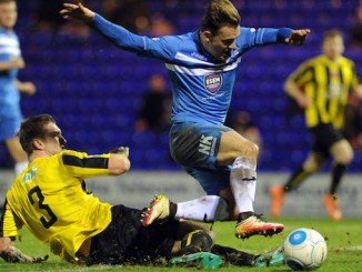 Danny Lloyd in action for Stockport County against Harrogate (M Photographic)