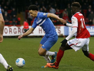 Lewis Montrose on the ball for Stockport County against Kidderminster
