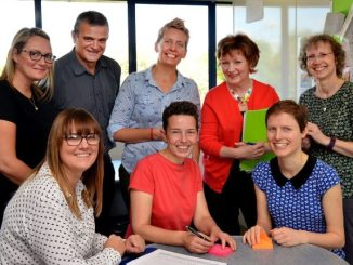 Empowered Conversations team with project manager Emma Smith, standing in the centre