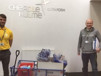 Science teacher Will Gray and deputy headteacher John Peet with the equipment donated to the NHS