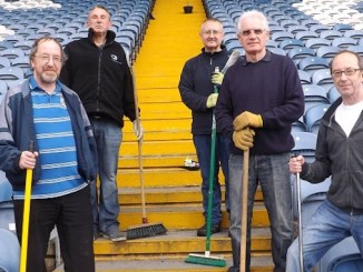 Volunteers from Help the Hatters clean up at Edgeley Park