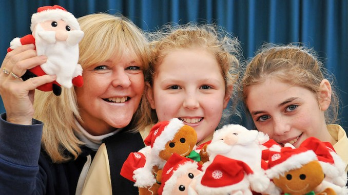 Kate Puc is pictured with Loreto's top fundraisers Grace Pegler (left) 10 and Amira McWilliams 10