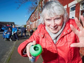 Move over Banksy , Levenshulme pensioner Jean Syed and her friends take to the street armed with spray paint, to help highlight the pavement faults in there local area (Mark Waugh)