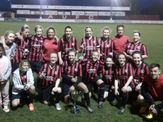 Burnage Metro FC Ladies pictured celebrating their cup success