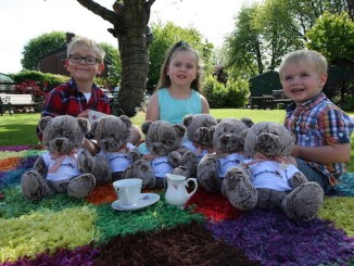 Pictured enjoying their Teddy Bear's Picnic with the Beechwood Bear at the centre on Chelford Grove in Bridgehall are from left to right Jack Day, aged 7, siblings Evie and Jacob Normansell, aged 4 and 2
