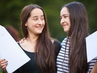 Identical twins Claire and Chloe Young from Parrs Wood High School