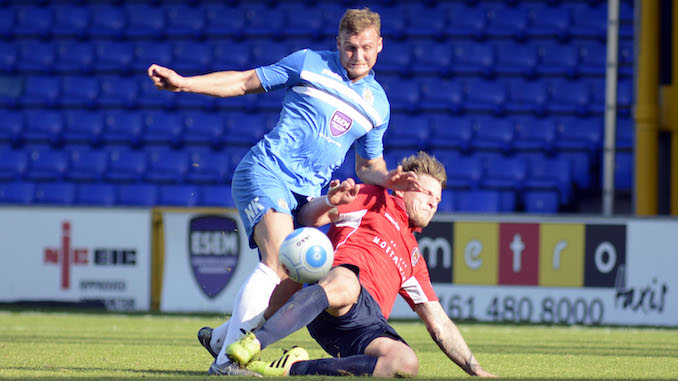 Josh Amis in action for Stockport County against Hyde United