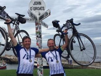Nick Lee, right, with friend Forbes Simpson, celebrates the end of the epic ride from Land's End to John O'Groats for Seashell Trust