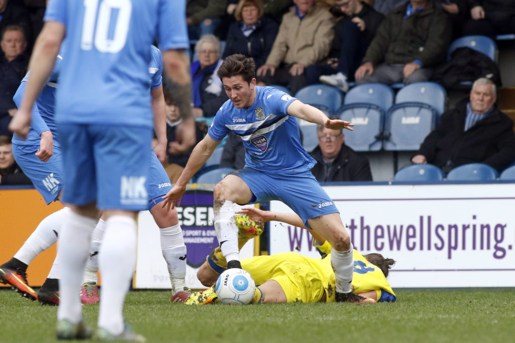 Connor Hampson rides a tackle for Stockport, against Chorley