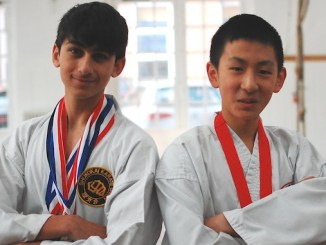Anton Sodha (left) and Aidan Lam, MGS pupils with their medals
