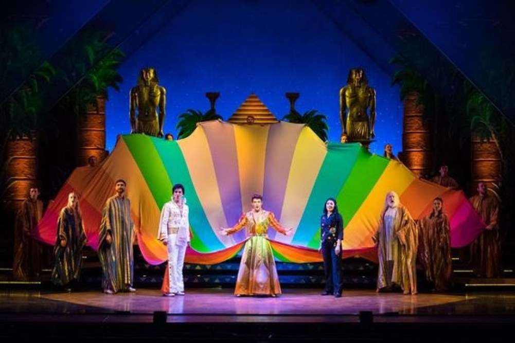 The cast of Joseph and the Amazing Technicolor Dreamcoat on stag at Stockport Plaza