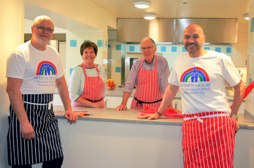 Dean Jenkins, Francis House chef, with volunteers Margaret Derbyshire and Derek Charleston with Simon Rimmer