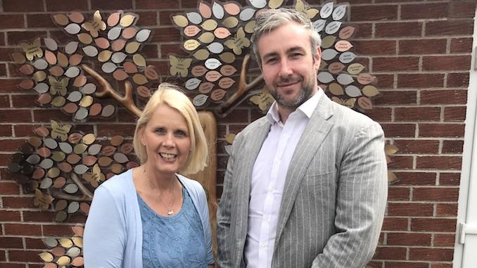 Angela Grey with Adam Deering, director at Pride Planning