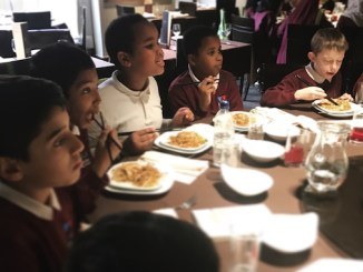 Pupils from Webster Primary School in Moss Side at the Yang Sing restaurant in Manchester