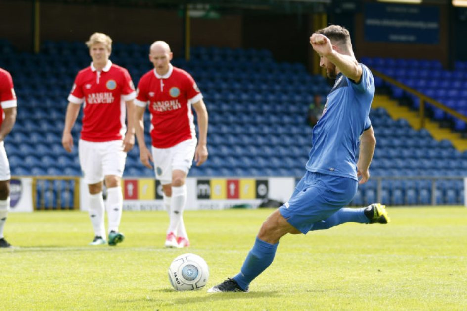 Matty Warburton scores from the spot for County