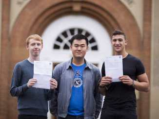 Tom Appleby and Limeng Zhu both from Didsbury with Adib Badhri from Wythenshawe celebrate their A-level results at The Manchester Grammar School (Chris Bull)