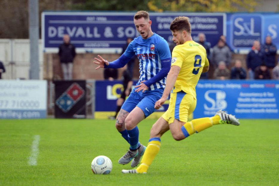 Jason Oswell goes for goal, for Stockport County, at Nuneaton Town