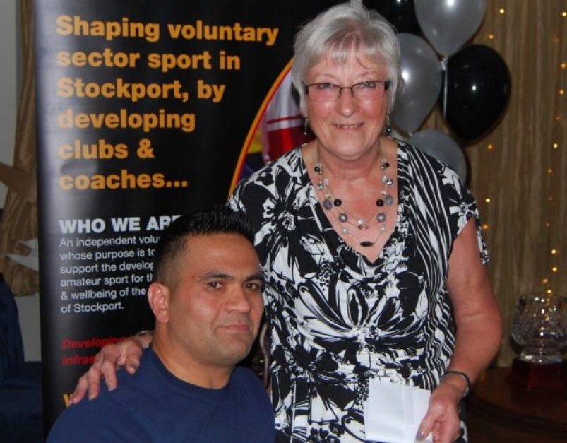 Abdul Ahmady receives his award from Val Cottam