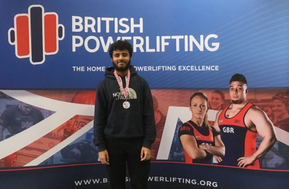 Shariq Haidery with his medal in Glasgow