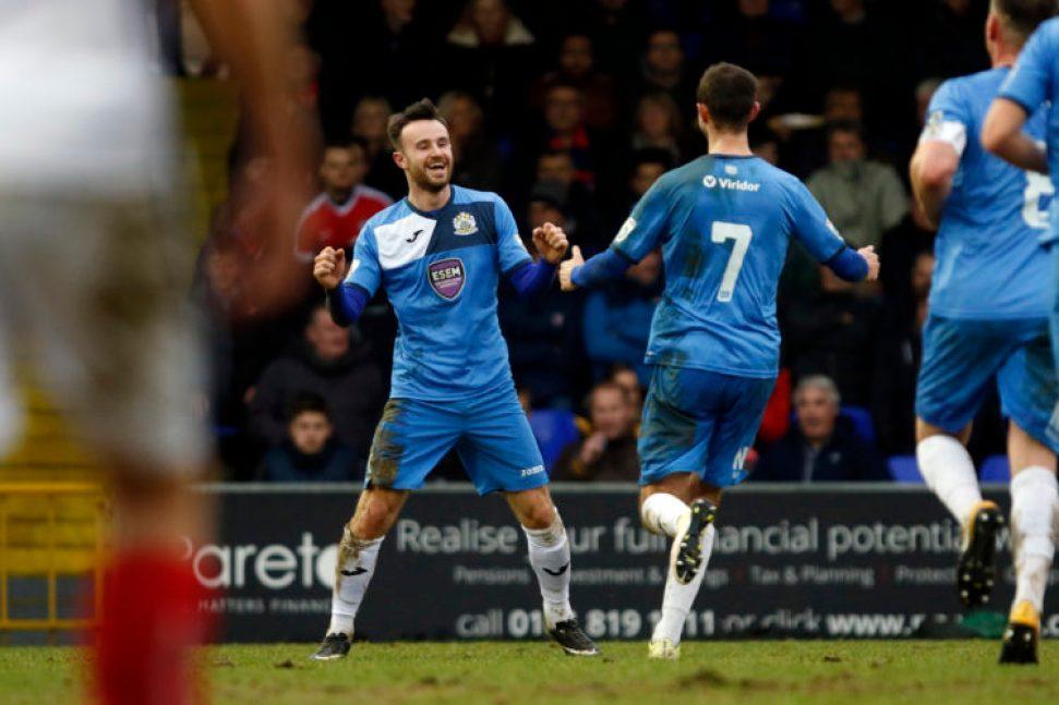 Matty Warburton celebrates his goal for Stockport County against York City