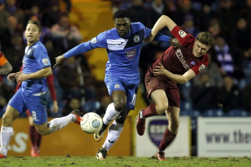 Darren Stephenson tussles for the ball, as Stockport lose to in form Nuneaton