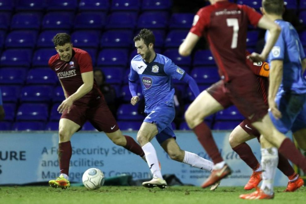 Adam Thomas on the ball for County, as the Hatters were beaten by Nuneaton Town