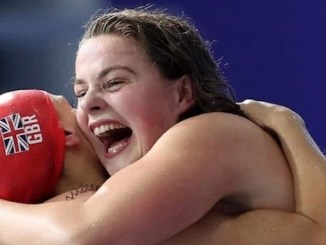 Holly Hibbott celebrates after winning gold in the European Championships 4x200m relay.