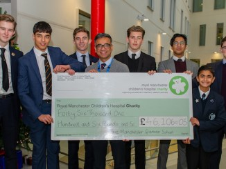 MGS boys present the cheque to Dr Omendra Narayan at Royal Manchester Children's Hospital