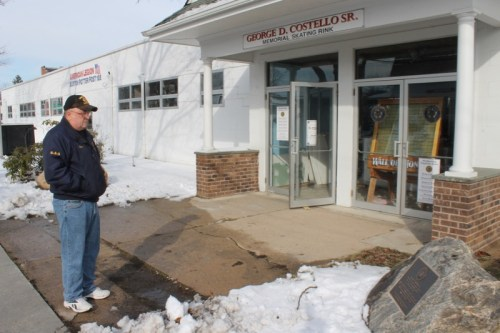Butch Corwin looks at a plaque in memory of his friend, USMC Cpl. George Costello Sr., set in a boulder at the entrance to the skating rink Costello was determined to renovate and reopen. Photo: Peter Blasl