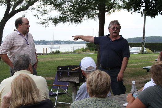 At an Aug. 31 meeting with residents, Mayor George Hubbard (right) explained that cash from the deal could go a long way to help Greenport, but that any health risks would take it off the table. File photo: Courtney Blasl.