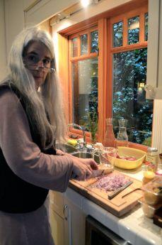 Carolyn is preparing red onion.