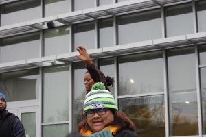Organizer Alicia Haskins prays in front of Emerald City Bible Fellowship prior to the march.